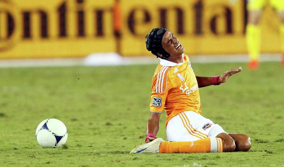 HOUSTON, TX - OCTOBER 06:Calen Carr #3 of the Houston Dynamo winces in pain after being clipped in the first half against the Montreal Impact at BBVA Compass Stadium on October 6, 2012 in Houston, Texas. Photo: Bob Levey, Getty Images / 2012 Getty Images