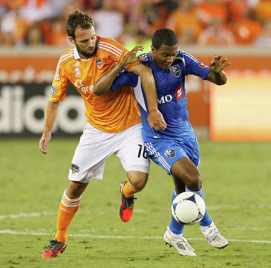 HOUSTON, TX - OCTOBER 06: Adam Moffat #16 of the Houston Dynamo and Patrice Bernier #8 of the Montreal Impact battle for possession of the ball in the first half at BBVA Compass Stadium on October 6, 2012 in Houston, Texas. Photo: Bob Levey, Getty Images / 2012 Getty Images