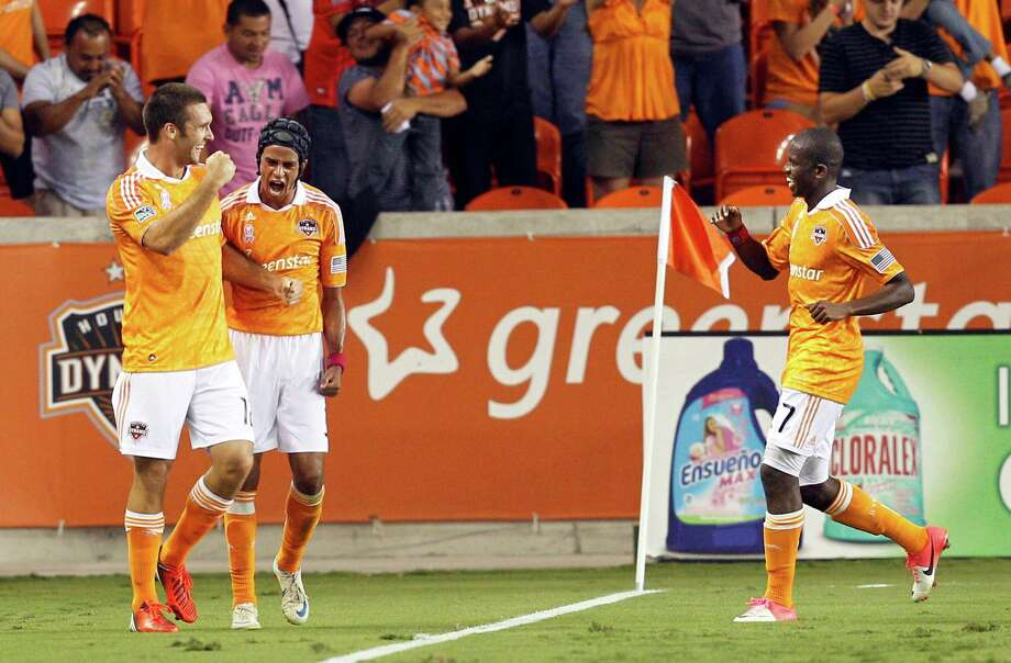 HOUSTON, TX - OCTOBER 06: Will Bruin #12 of the Houston Dynamo and Calen Carr #3 of the Houston Dynamo along with Boniek Garcia #27 of the Houston Dynamo celebrate Bruin's goal in the first half against the Montreal Impact at BBVA Compass Stadium on October 6, 2012 in Houston, Texas. Photo: Bob Levey, Getty Images / 2012 Getty Images