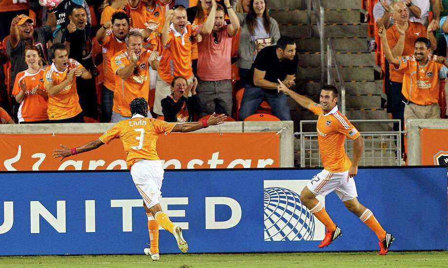 HOUSTON, TX - OCTOBER 06: Will Bruin #12 of the Houston Dynamo and Calen Carr #3 of the Houston Dynamo celebrate Bruin's goal in the first half against the Montreal Impact at BBVA Compass Stadium on October 6, 2012 in Houston, Texas. Photo: Bob Levey, Getty Images / 2012 Getty Images