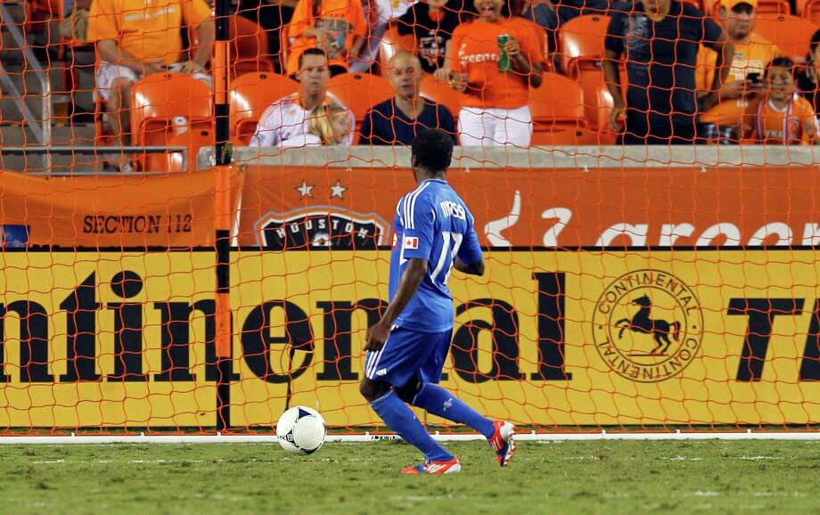 HOUSTON, TX - OCTOBER 06:  Sanna Nyassi #11 of the Montreal Impact scores in the open net on a rebound from Tally Hall #1 of the Houston Dynamo in the second half at BBVA Compass Stadium on October 6, 2012 in Houston, Texas. Montreal and Houston played to 1-1 tie. Photo: Bob Levey, Getty Images / 2012 Getty Images