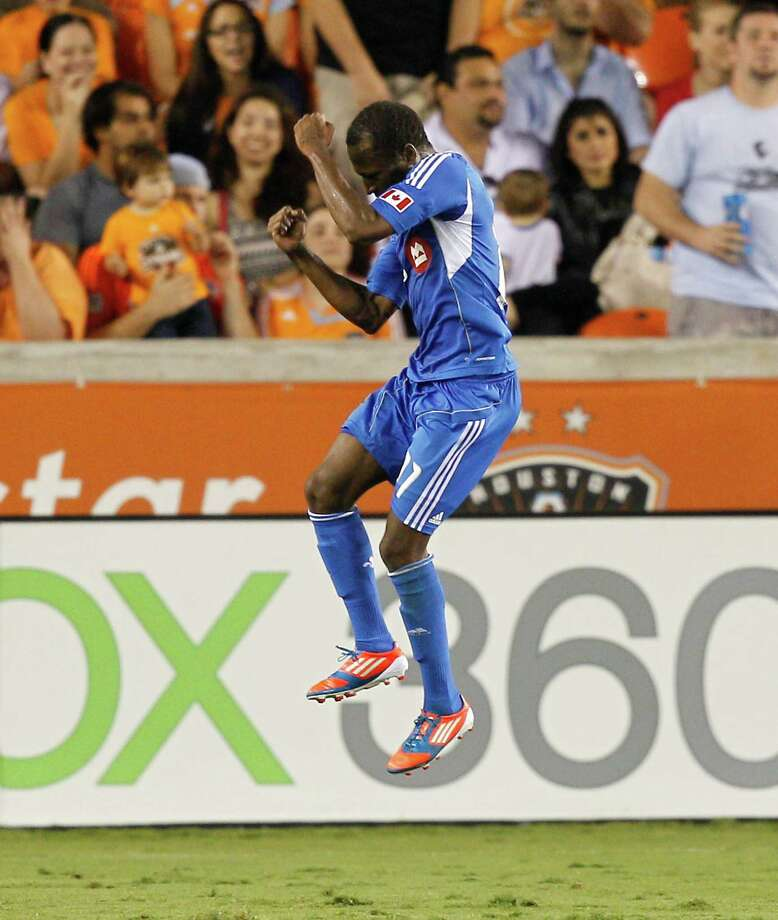 HOUSTON, TX - OCTOBER 06:  Sanna Nyassi #11 of the Montreal Impact celebrates his goal in the second half against the Houston Dynamo at BBVA Compass Stadium on October 6, 2012 in Houston, Texas. Montreal and Houston played to 1-1 tie. Photo: Bob Levey, Getty Images / 2012 Getty Images