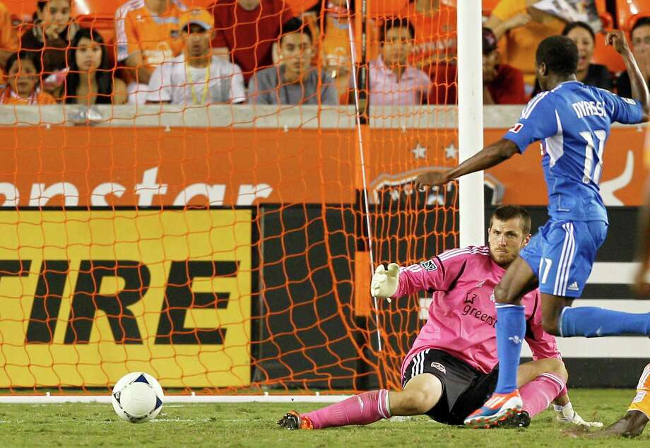 HOUSTON, TX - OCTOBER 06: Tally Hall #1 of the Houston Dynamo makes the initial save on a shot by Sanna Nyassi #11 of the Montreal Impact in the second half  at BBVA Compass Stadium on October 6, 2012 in Houston, Texas. Montreal and Houston played to 1-1 tie. Photo: Bob Levey, Getty Images / 2012 Getty Images
