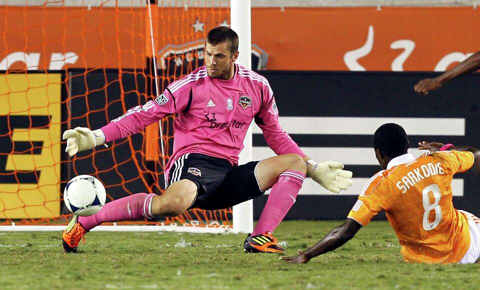 HOUSTON, TX - OCTOBER 06: Tally Hall #1 of the Houston Dynamo makes the initial save on a shot by Sa