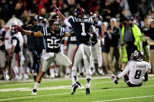 OXFORD, MS - OCTOBER 06: Cody Prewitt #25 and Dehendret Collins #1 of the Ole Miss Rebels react to an interception during a game against the Texas A&M Aggies at Vaught-Hemingway Stadium on October 6, 2012 in Oxford, Mississippi. Photo: Stacy Revere, Getty Images / 2012 Getty Images