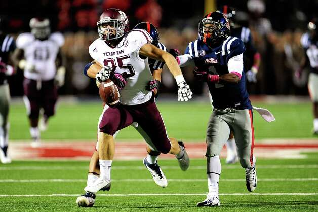 OXFORD, MS - OCTOBER 06: Ryan Swope #25 of the Texas A&M Aggies is stripped of the ball by Cody Prewitt #25 of the Ole Miss Rebels during a game at Vaught-Hemingway Stadium on October 6, 2012 in Oxford, Mississippi. Photo: Stacy Revere, Getty Images / 2012 Getty Images