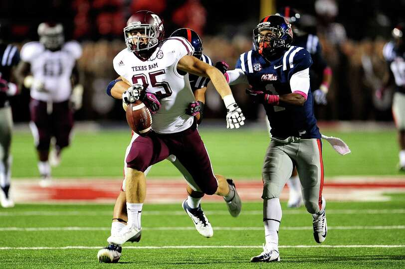 OXFORD, MS - OCTOBER 06: Ryan Swope #25 of the Texas A&M Aggies is stripped of the ball by Cody Prew