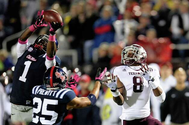 OXFORD, MS - OCTOBER 06: Dehendret Colins #1 of the Ole Miss Rebels intercepts a pass intended for Thomas Johnson #8 of the Texas A&M Aggies during a game at Vaught-Hemingway Stadium on October 6, 2012 in Oxford, Mississippi. Photo: Stacy Revere, Getty Images / 2012 Getty Images