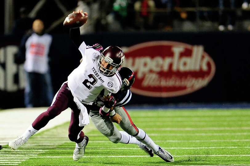 OXFORD, MS - OCTOBER 06: Johnny Manziel #2 of the Texas A&M Aggies is tackled by LaKedrick King #28