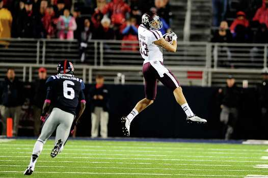 OXFORD, MS - OCTOBER 06: Mike Evans #13 of the Texas A&M Aggies catches a pass in front of Wesley Pendleton #6 of the Ole Miss Rebels during a game at Vaught-Hemingway Stadium on October 6, 2012 in Oxford, Mississippi. Photo: Stacy Revere, Getty Images / 2012 Getty Images