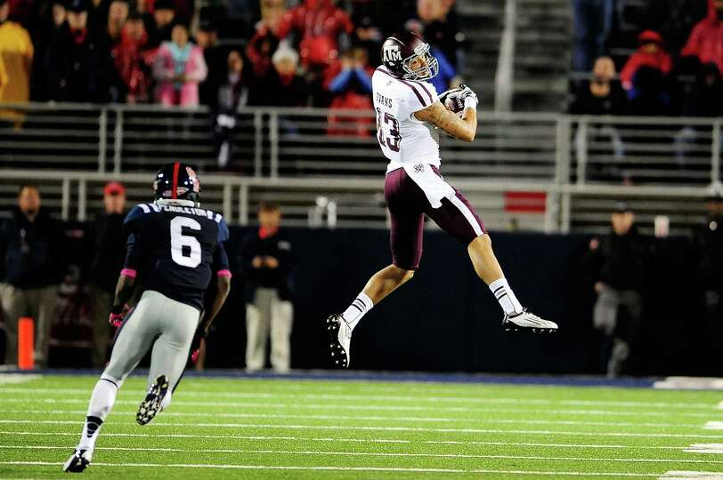 OXFORD, MS - OCTOBER 06: Mike Evans #13 of the Texas A&M Aggies catches a pass in front of Wesley Pe