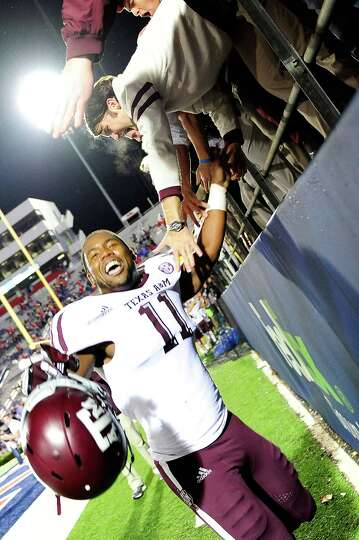 OXFORD, MS - OCTOBER 06: Derel Walker #11 of the Texas A&M Aggies celebrates with fans following a v