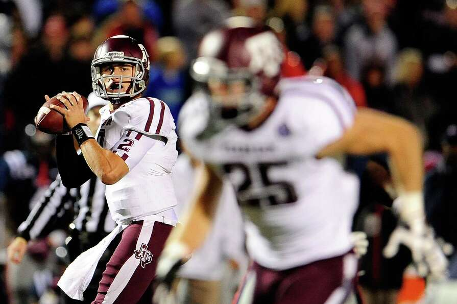 OXFORD, MS - OCTOBER 06: Johnny Manziel #2 of the Texas A&M Aggies drops back to pass against the Ol