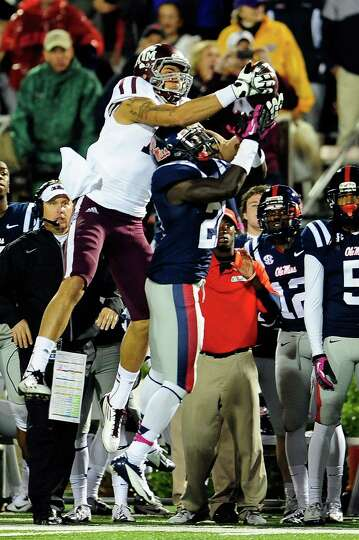 OXFORD, MS - OCTOBER 06: Mike Evans #13 of the Texas A&M Aggies catches a pass over Senquez Golson #