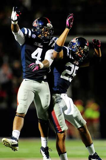 OXFORD, MS - OCTOBER 06: Cody Prewitt #25 and Denzel Nkemdiche #4 of the Ole Miss Rebels celebrate a