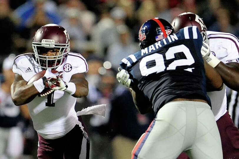 OXFORD, MS - OCTOBER 06: Ben Malena #1 of the Texas A&M Aggies runs for yards against the Ole Miss R