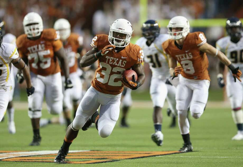 AUSTIN, TX - OCTOBER 06:  Johnathan Gray #32 of the Texas Longhorns runs the ball against the West Virginia Mountaineers at Darrell K Royal-Texas Memorial Stadium on October 6, 2012 in Austin, Texas. Photo: Ronald Martinez, Getty Images / 2012 Getty Images