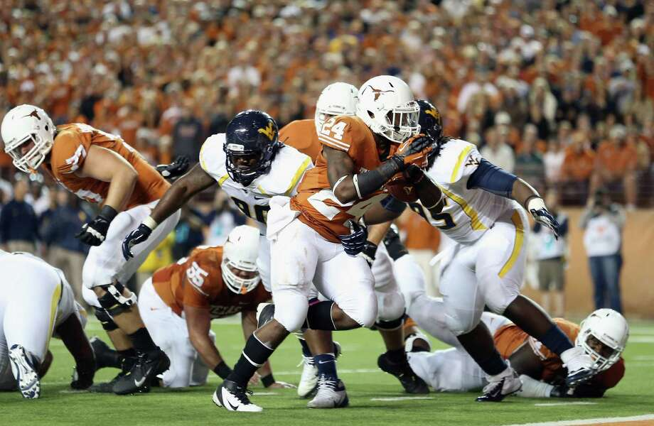 AUSTIN, TX - OCTOBER 06:  Joe Bergeron #24 of the Texas Longhorns runs for a touchdown against the West Virginia Mountaineers at Darrell K Royal-Texas Memorial Stadium on October 6, 2012 in Austin, Texas. Photo: Ronald Martinez, Getty Images / 2012 Getty Images