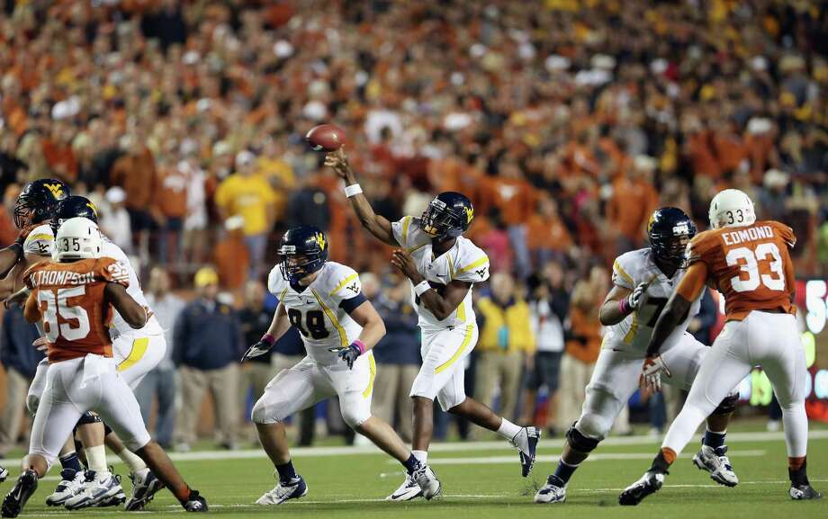 AUSTIN, TX - OCTOBER 06:  Geno Smith #12 of the West Virginia Mountaineers throws the ball against the Texas Longhorns at Darrell K Royal-Texas Memorial Stadium on October 6, 2012 in Austin, Texas. Photo: Ronald Martinez, Getty Images / 2012 Getty Images