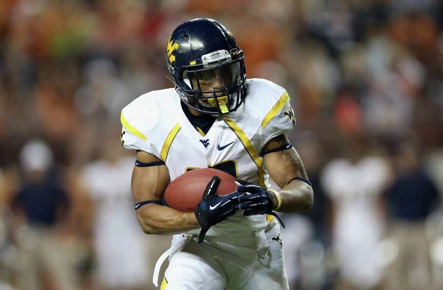 AUSTIN, TX - OCTOBER 06:  Andrew Buie #13 of the West Virginia Mountaineers runs the ball against th