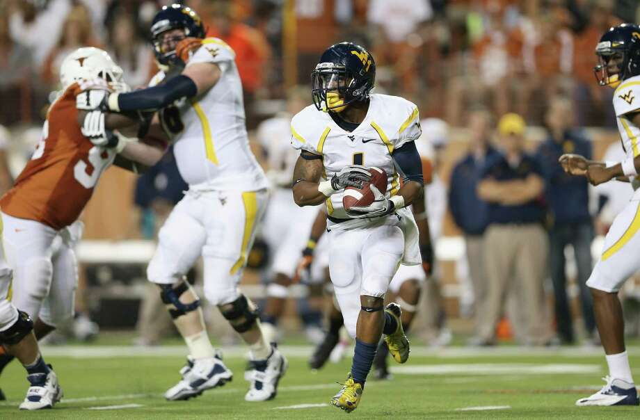 AUSTIN, TX - OCTOBER 06:  Tavon Austin #1 of the West Virginia Mountaineers runs the ball against the Texas Longhorns at Darrell K Royal-Texas Memorial Stadium on October 6, 2012 in Austin, Texas. Photo: Ronald Martinez, Getty Images / 2012 Getty Images