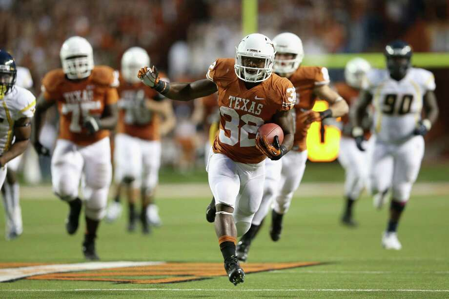 West Virginia 48, Texas 45AUSTIN, TX - OCTOBER 06:  Johnathan Gray #32 of the Texas Longhorns runs the ball against the West Virginia Mountaineers at Darrell K Royal-Texas Memorial Stadium on October 6, 2012 in Austin, Texas. Photo: Ronald Martinez, Getty Images / 2012 Getty Images