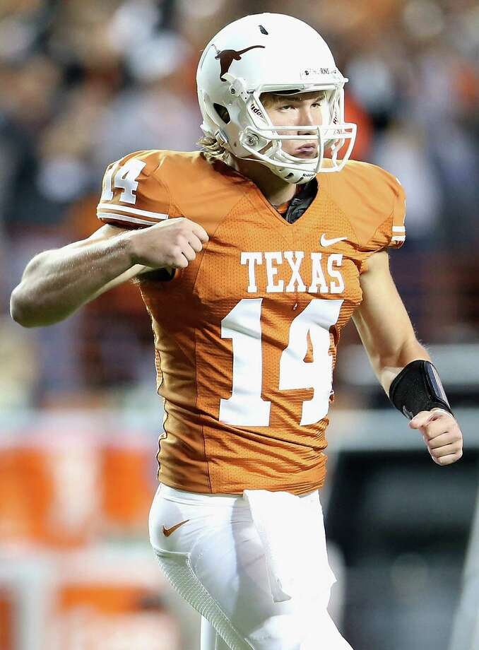 AUSTIN, TX - OCTOBER 06:  David Ash #14 of the Texas Longhorns celebrates a touchdown against the West Virginia Mountaineers at Darrell K Royal-Texas Memorial Stadium on October 6, 2012 in Austin, Texas. Photo: Ronald Martinez, Getty Images / 2012 Getty Images