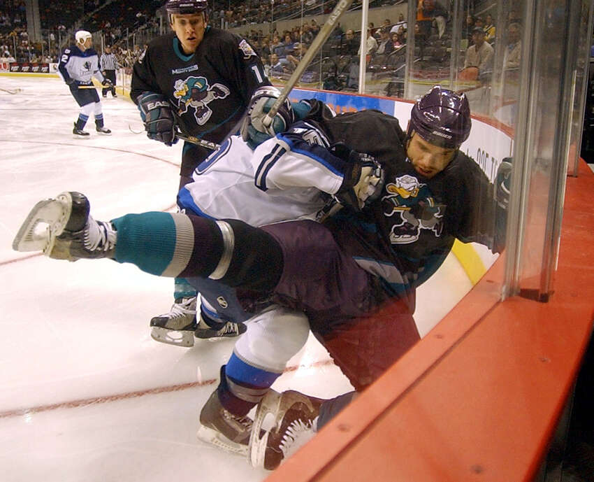 FIRST SEASON, 2002-2003: The Rampage's David Gove (in white) drives Cincinnati's Cam Severson into the wall during action at the SBC Center on Nov. 6, 2002.