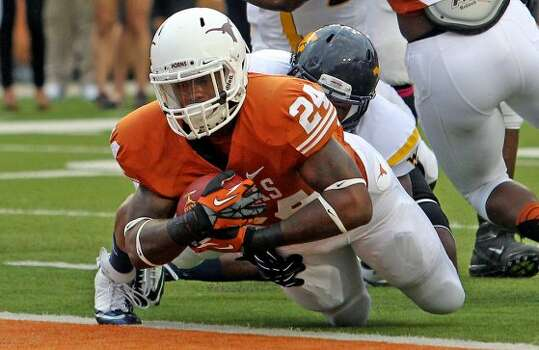 Joe Bergeron gets into the endzone for the Longhorns in the first quarter as Texas hosts West Virginia at Darrel K. Royal Texas Memorial Stadium in Austin on October 6, 2012. (San Antonio Express-News)