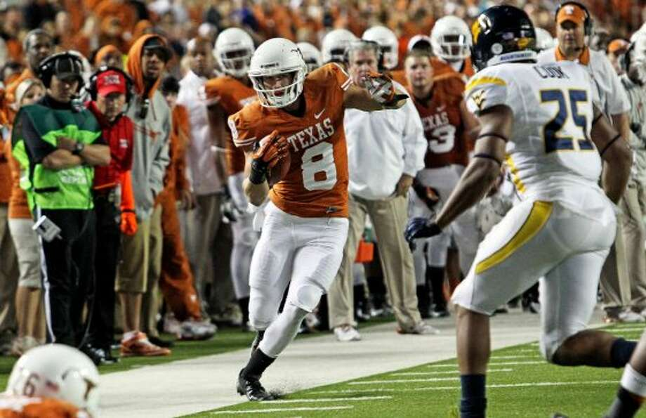 Jaxon Shipley tip toes the sideline in the second half as Texas hosts West Virginia at Darrel K. Royal Texas Memorial Stadium in Austin on October 6, 2012. (San Antonio Express-News)