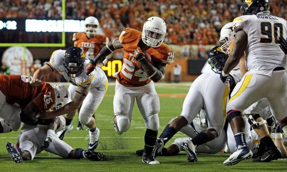 Joe Bergeron finds a big hole for a Longhorn touchdown in the second half as Texas hosts West Virginia at Darrel K. Royal Texas Memorial Stadium in Austin on October 6, 2012. (San Antonio Express-News)