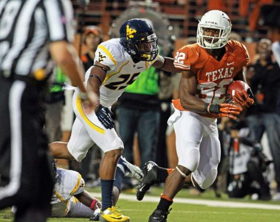 Johnathan Gray breaks away for the Longhorns in the second quarter for a long gain as Texas hosts West Virginia at Darrel K. Royal Texas Memorial Stadium in Austin on October 6, 2012. (San Antonio Express-News)