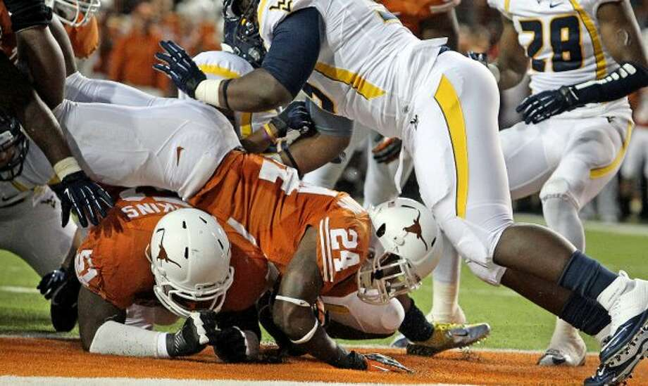 Joe Bergeron slides through for atouchdown in the second quarter as Texas hosts West Virginia at Darrel K. Royal Texas Memorial Stadium in Austin on October 6, 2012. (San Antonio Express-News)