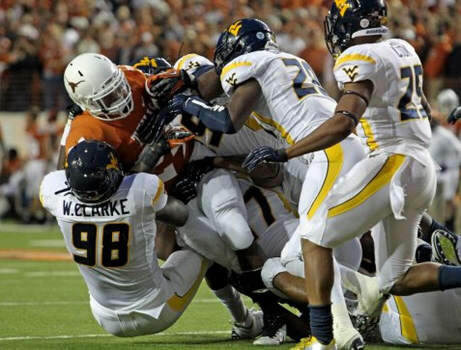 Longhorn running back Joe Bergeron gets stopped behind the line as Texas hosts West Virginia at Darrel K. Royal Texas Memorial Stadium in Austin on October 6, 2012. (San Antonio Express-News)
