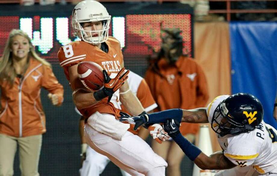 Jaxon Shipley sees the ball slip from his hands in the end zone in the fourth quarter as Texas hosts West Virginia at Darrel K. Royal Texas Memorial Stadium in Austin on October 6, 2012. (San Antonio Express-News)