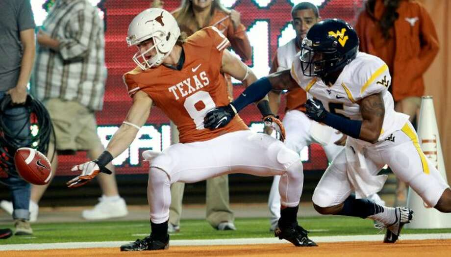 Longhorn receiver Jaxon Shipley can't catch up to the ball in the end zone as Texas hosts West Virginia at Darrel K. Royal Texas Memorial Stadium in Austin on October 6, 2012. (San Antonio Express-News)
