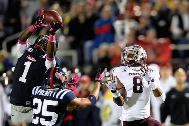 OXFORD, MS - OCTOBER 06:  Dehendret Colins #1 of the Ole Miss Rebels intercepts a pass intended for Thomas Johnson #8 of the Texas A&M Aggies during a game at Vaught-Hemingway Stadium on October 6, 2012 in Oxford, Mississippi.  (Photo by Stacy Revere/Getty Images) (Getty Images)