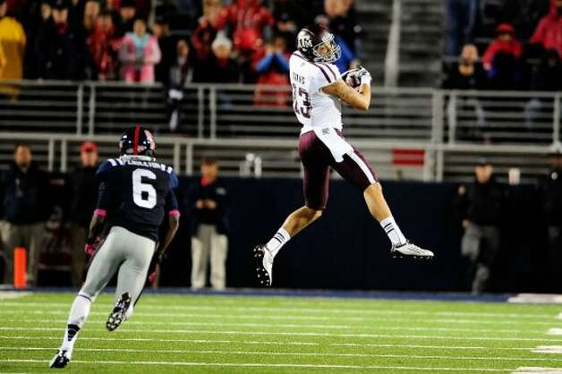 OXFORD, MS - OCTOBER 06:  Mike Evans #13 of the Texas A&M Aggies catches a pass in front of Wesley Pendleton #6 of the Ole Miss Rebels during a game at Vaught-Hemingway Stadium on October 6, 2012 in Oxford, Mississippi.  (Photo by Stacy Revere/Getty Images) (Getty Images)