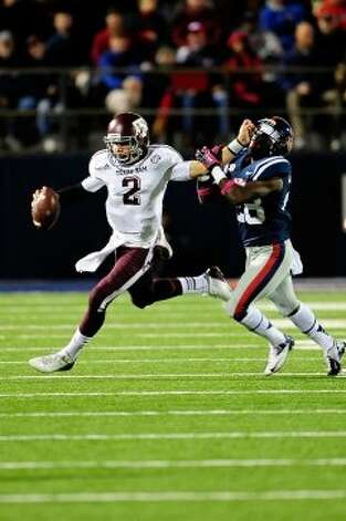 OXFORD, MS - OCTOBER 06:  Johnny Manziel #2 of the Texas A&M Aggies stiff arms LaKedrick King #28 of the Ole Miss Rebels during a game at Vaught-Hemingway Stadium on October 6, 2012 in Oxford, Mississippi.  (Photo by Stacy Revere/Getty Images) (Getty Images)