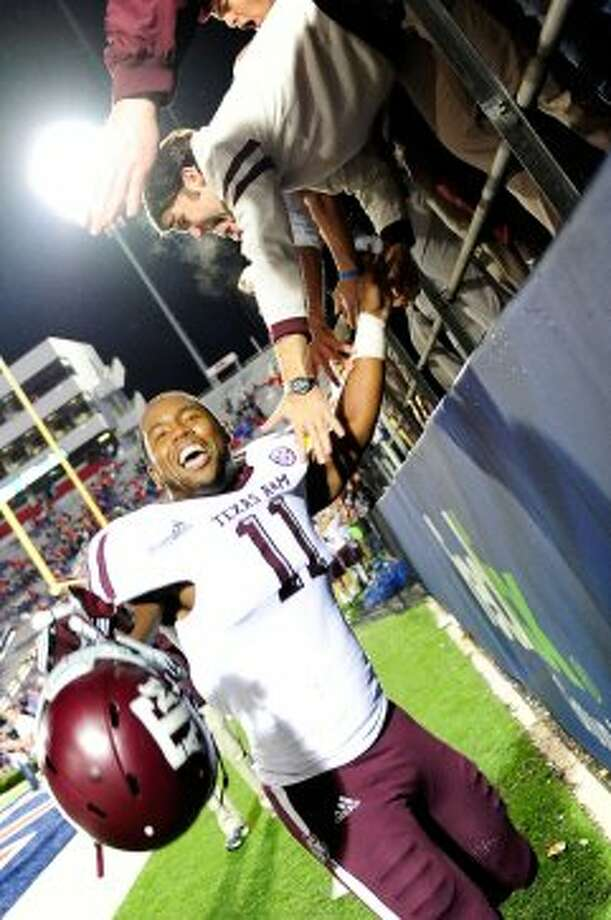 OXFORD, MS - OCTOBER 06:  Derel Walker #11 of the Texas A&M Aggies celebrates with fans following a victory over the Ole Miss Rebels at Vaught-Hemingway Stadium on October 6, 2012 in Oxford, Mississippi.  (Photo by Stacy Revere/Getty Images) (Getty Images)