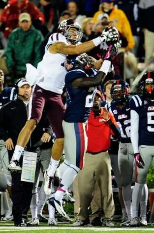 OXFORD, MS - OCTOBER 06:  Mike Evans #13 of the Texas A&M Aggies catches a pass over Senquez Golson #21 of the Ole Miss Rebels during a game at Vaught-Hemingway Stadium on October 6, 2012 in Oxford, Mississippi.  (Photo by Stacy Revere/Getty Images) (Getty Images)
