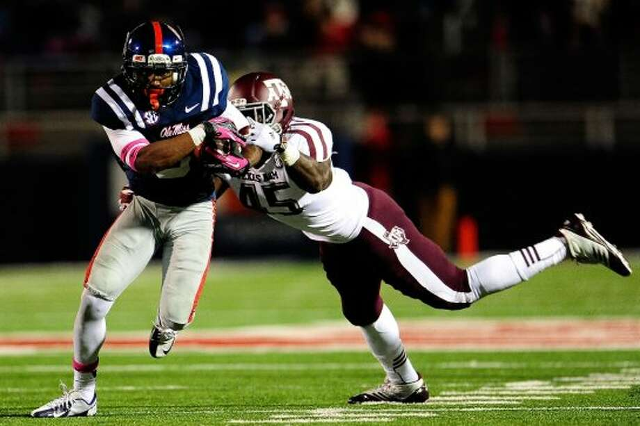 OXFORD, MS - OCTOBER 06:  Jeff Scott #3 of the Ole Miss Rebels breaks a tackle by Steven Jenkins #45 of the Texas A&M Aggies during a game at Vaught-Hemingway Stadium on October 6, 2012 in Oxford, Mississippi.  (Photo by Stacy Revere/Getty Images) (Getty Images)