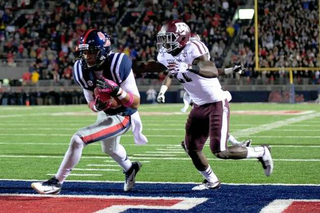 OXFORD, MS - OCTOBER 06:  Donte Moncrief #12 of the Ole Miss Rebels catches a touchdown pass in front of Steven Terrell #21 of the Texas A&M Aggies during a game at Vaught-Hemingway Stadium on October 6, 2012 in Oxford, Mississippi.  (Photo by Stacy Revere/Getty Images) (Getty Images)