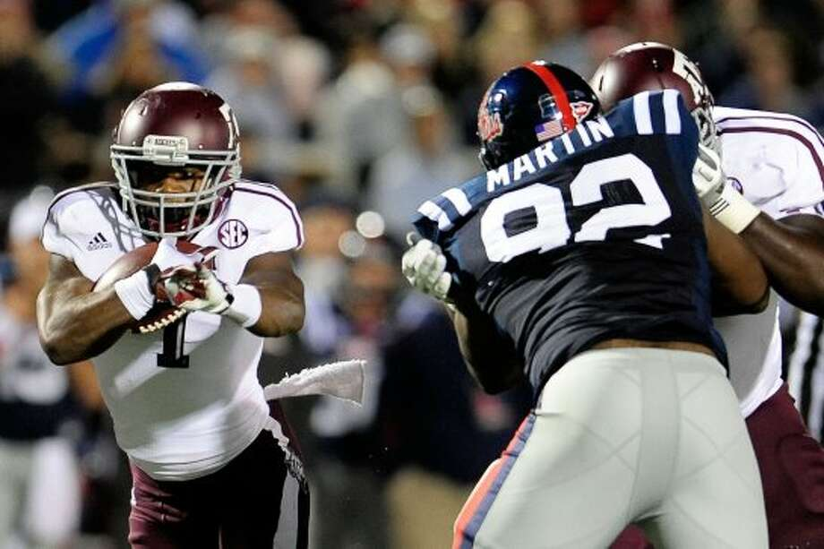 OXFORD, MS - OCTOBER 06:  Ben Malena #1 of the Texas A&M Aggies runs for yards against the Ole Miss Rebels during a game at Vaught-Hemingway Stadium on October 6, 2012 in Oxford, Mississippi.  (Photo by Stacy Revere/Getty Images) (Getty Images)
