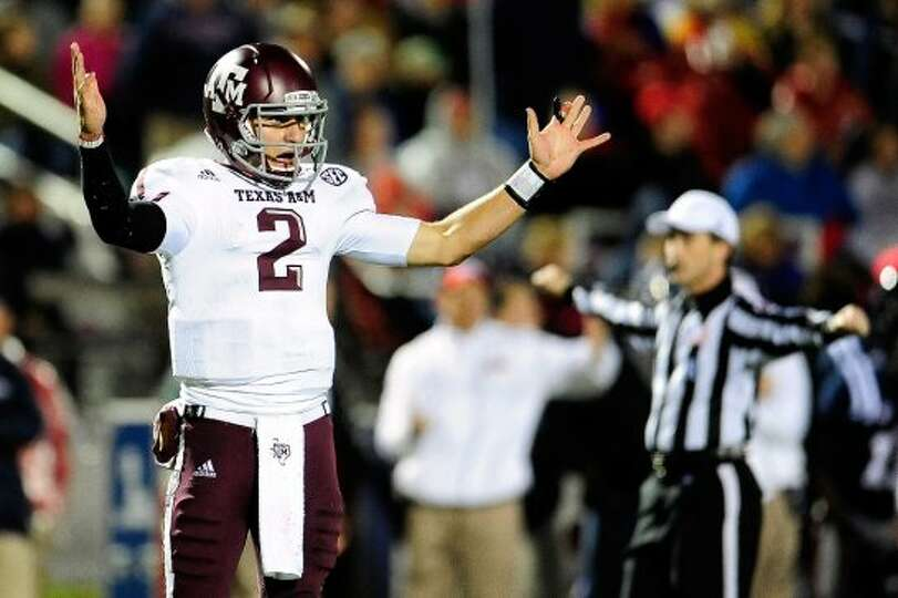 OXFORD, MS - OCTOBER 06:  Johnny Manziel #2 of the Texas A&M Aggies reacts to a call during a game a