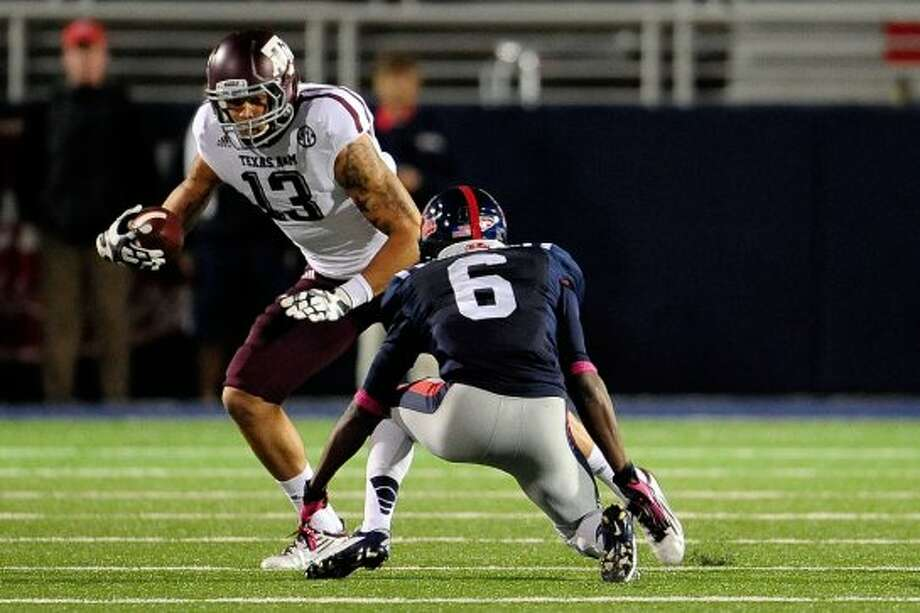 OXFORD, MS - OCTOBER 06:  Mike Evans #13 of the Texas A&M Aggies tries to avoid Desmond Gardiner #6 of the Ole Miss Rebels during a game at Vaught-Hemingway Stadium on October 6, 2012 in Oxford, Mississippi.  (Photo by Stacy Revere/Getty Images) (Getty Images)