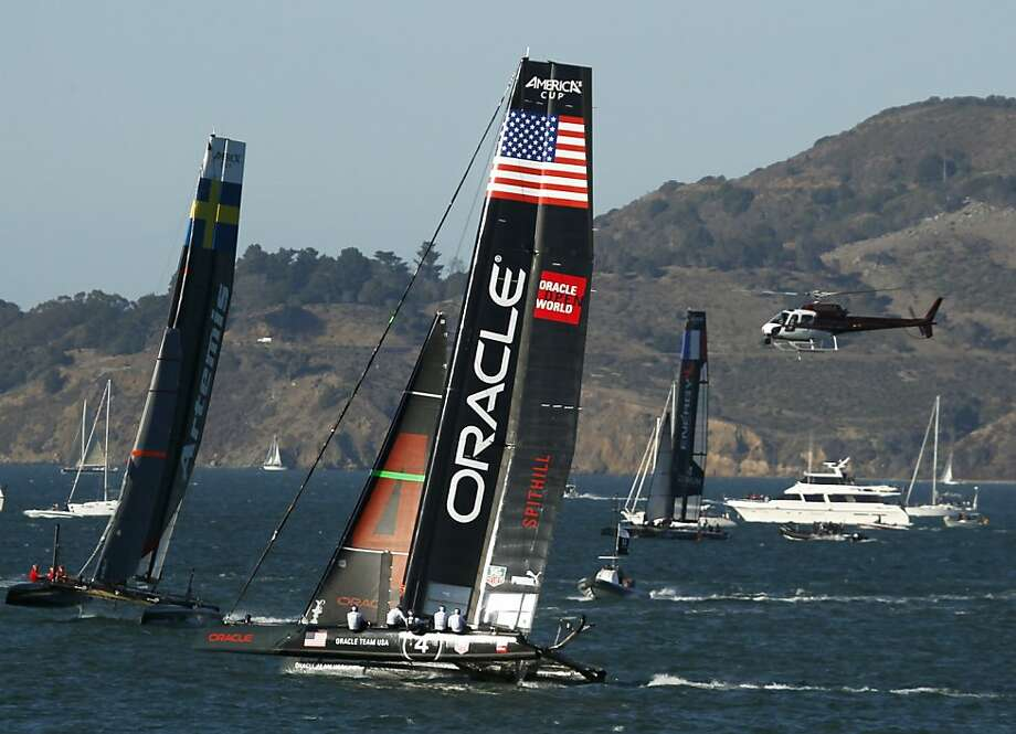 Oracle Team USA Spithill pulls away from Artemus Racing White (left) in a semifinal match race in the America's Cup World Series in San Francisco, Calif. on Saturday, Oct. 6, 2012.  Spithill went on to win the match finals over Emirates Team New Zealand. Photo: Paul Chinn, The Chronicle
