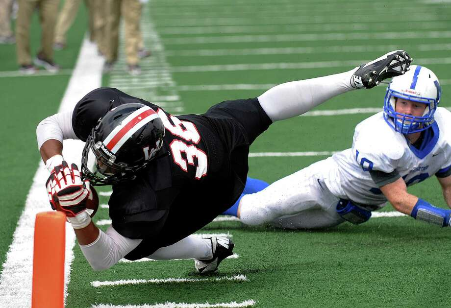 Churchill's Dimitri Flowers dives, but falls short of the end zone as Steven Baker of MacArthur watches during high school football action at Comalander Stadium on Saturday, Oct. 6, 2012. Photo: Billy Calzada, Express-News / © San Antonio Express-News