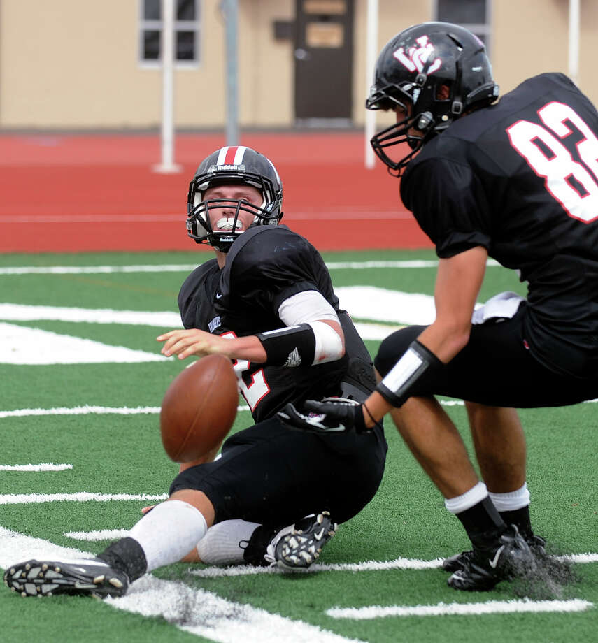 Churchill quarterback Nate Pearson, left, fumbles the ball after a 54-yard run as teammate Lucas Saenz (82) watches during high school football action against MacArthur at Comalander Stadium on Saturday, Oct. 6, 2012. Photo: Billy Calzada, Express-News / © San Antonio Express-News