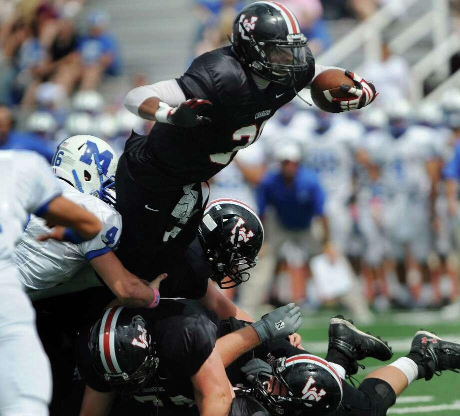 Oct. 6:Dimitri Flowers of Churchill runs for yardage against MacArthur at Comalander Stadium. Photo: Billy Calzada, Express-News / © San Antonio Express-News